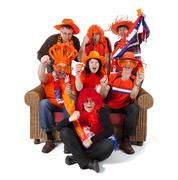 group of dutch soccer fan watching game over white background - stock photo