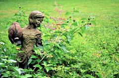 girl statue in garden - background-1 - stock photo