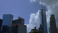 Stock Video Footage of Freedom Tower NYC world trade reflecting clouds. construction