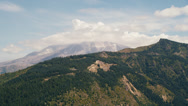 Stock Video Footage of Wide aerial shot of Mt. St. Helens, shrouded in clouds