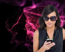 Concentrated elegant brunette wearing sunglasses texting Stock Illustration