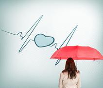 Businesswoman standing back to camera holding umbrella - stock illustration