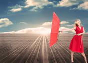 Stock Illustration of Attractive glamour woman holding a broken umbrella