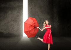 Stock Illustration of Beautiful woman wearing red dress holding umbrella