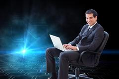 Composite image of businessman sitting on an armchair working with a laptop Stock Illustration