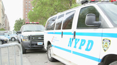 New York Police Van-Housing Project in Background Stock Footage