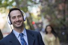 A man with headphones listening to music Stock Photos