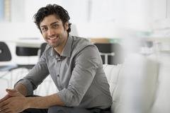 Stock Photo of A businessman seated relaxing