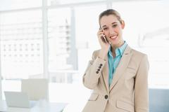 Portrait of chic businesswoman phoning with her smartphone Stock Photos