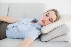 Stock Photo of Cute classy businesswoman sleeping on her couch