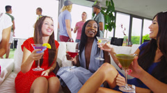 Happy female friends drinking cocktails raise their glasses for a toast Stock Footage