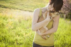 A woman and her pet chihuahua dog - stock photo