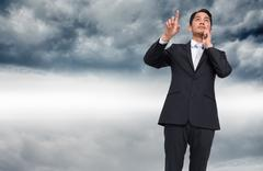 Stock Illustration of Composite image of thoughtful businessman pointing