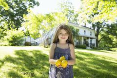 A young girl holding fresh lemons Stock Photos