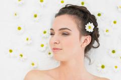 Stock Photo of Beautiful woman with flowers in beauty salon
