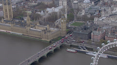 Aerial view of traffic crossing the Thames in the London city of Westminster Stock Footage