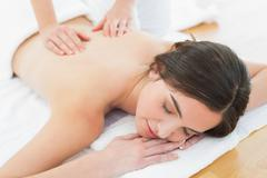 Stock Photo of Woman enjoying back massage at beauty spa