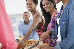 A group of people at a buffet table Stock Photos