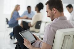 Meeting with one person using a tablet - stock photo