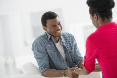 Stock Photo of Two people talking face to face