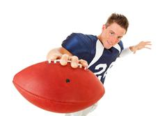 Football: player holding ball to camera Stock Photos