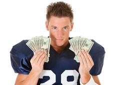 football: holding fanned out cash - stock photo