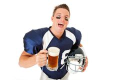 Stock Photo of football: laughing player with beer