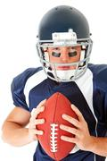 football: serious player with ball - stock photo