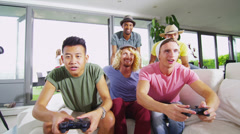 Happy group of male friends playing video games at home Stock Footage