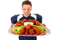 Football: holding platter of chicken wings Stock Photos
