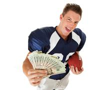 Stock Photo of football: player with fanned money and ball