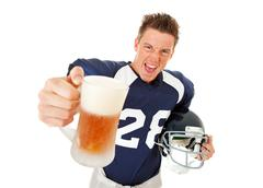 Football: player making toast with beer Stock Photos