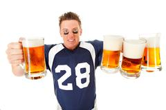 football: holding up lots of beer - stock photo