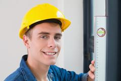 Close up of a handyman using a spirit level - stock photo