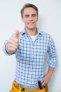 Portrait of a handyman gesturing thumbs up Stock Photos