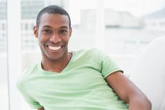 Portrait of a relaxed smiling young Afro man - stock photo