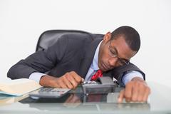 Afro businessman resting at desk over white background - stock photo