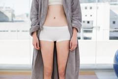 Mid section of woman in shorts and bathrobe - stock photo