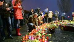 Candle heap, people with candles near Starvation (Holodomor) monument. Stock Footage
