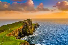 colorful ocean coast sunset at neist point lighthouse, scotland - stock photo