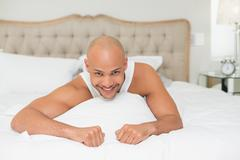 Stock Photo of Close up portrait of a man resting in bed