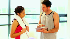 Handsome coach talking to sporty woman Stock Footage