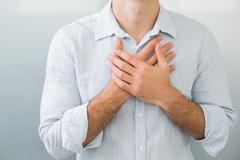Mid section of a man with chest pain - stock photo