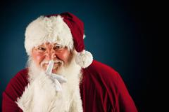 Stock Photo of santa: santa keeping a secret