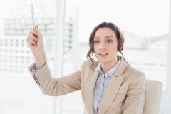Thoughtful elegant businesswoman with a pen in office Stock Photos
