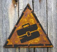 Briefcase Icon on Rusty Warning Sign. Stock Illustration