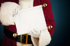 Santa: holding a blank scroll list Stock Photos
