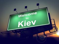 Billboard Welcome to Kiev at Sunrise. - stock illustration