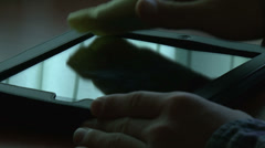 Man cleaning digital tablet - stock footage