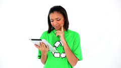 Cute thinking environmental activist working with her tablet Stock Footage